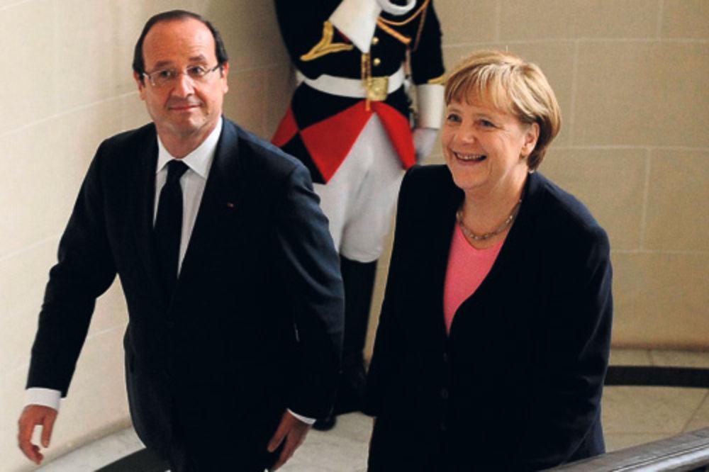 Oland i Merkelova na proslavi u Remsu