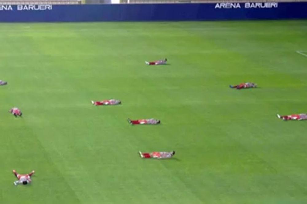 U znak solidarnosti sa večitim rivalom igrači polegali na travu Fudbal-foto-printskrin-1408273039-552395