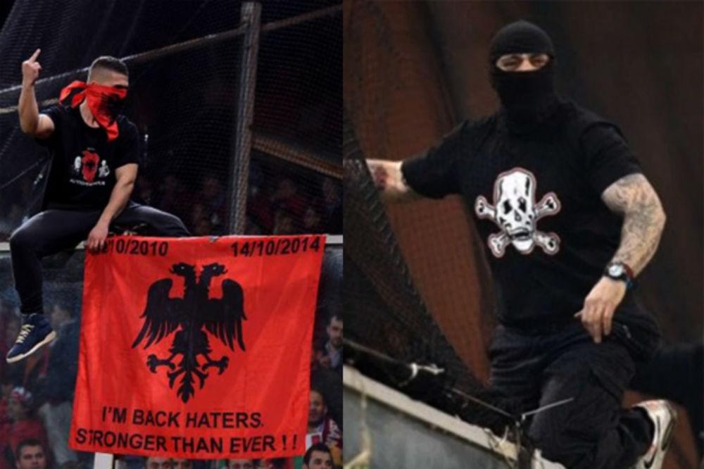 ISKOPIRAO BOGDANOVA: Albanski navijač sa zastavom i srednjim prstom na ogradi stadiona u Đenovi