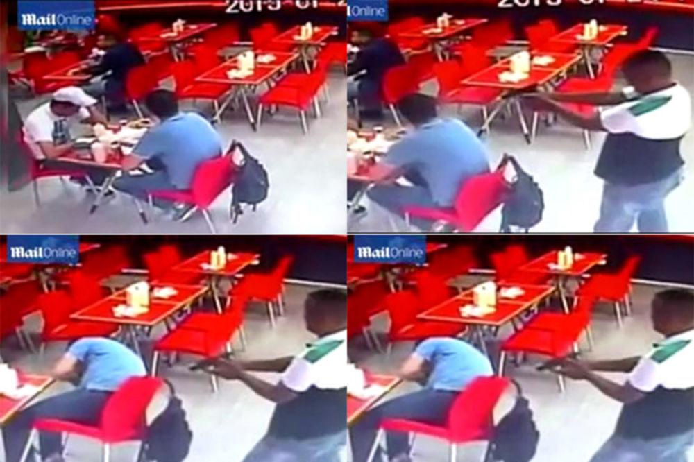 (UZNEMIRUJUĆI VIDEO 18+) NAOČIGLED SVIH: Upucao čoveka u glavu usred restorana i mirno otišao
