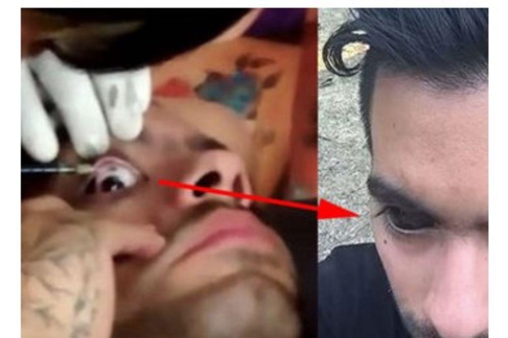 SADA SMO SVE VIDELI: Momak je snimio video kako tetovira očne jabučice...Ne gledajte dok jedete!