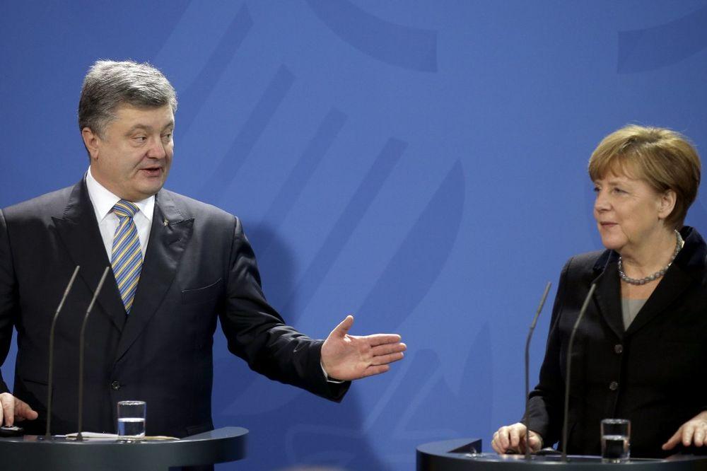 POROŠENKO I MERKELOVA: Sankcije Rusiji treba da ostanu