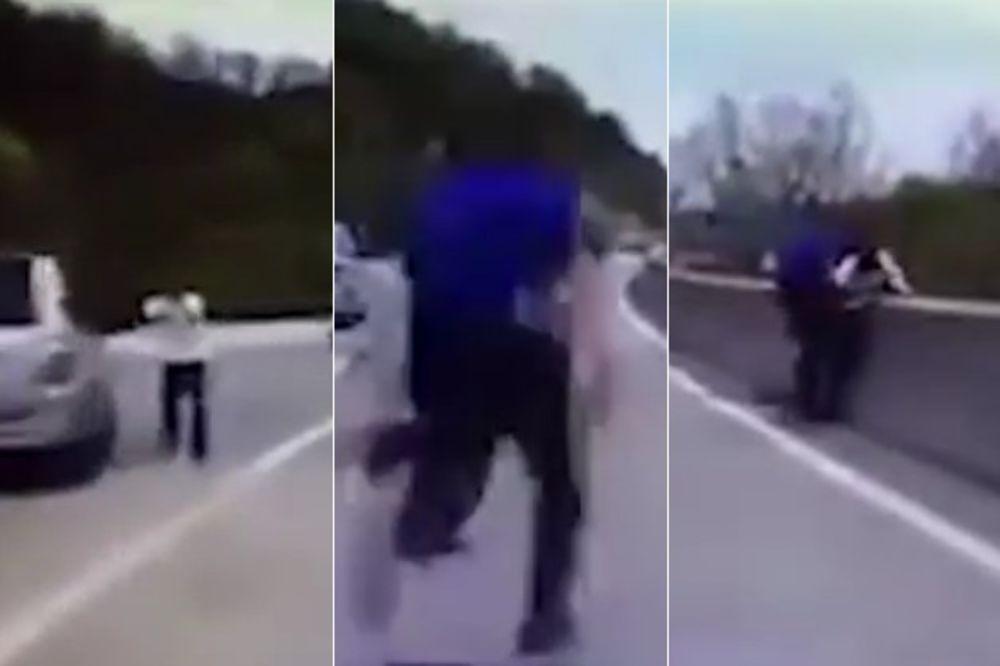 (VIDEO) DRAMATIČAN SNIMAK SUPERHEROJA: Policajac spasao čoveku život sprečivši ga da skoči s mosta