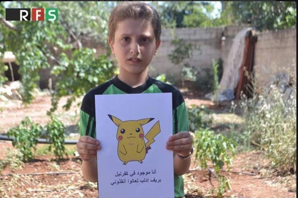 POTRESNA PORUKA SIRIJSKIH DEČAKA: Evo zašto deca iz Alepa drže slike Pokemona