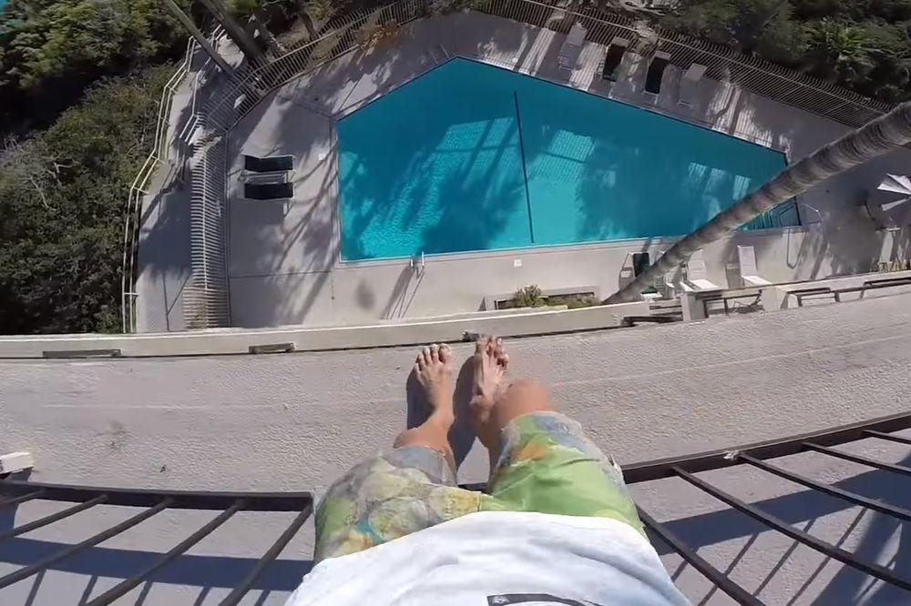 (VIDEO) LUDA HRABROST: Skočio sa vrha petospratnog hotela u bazen