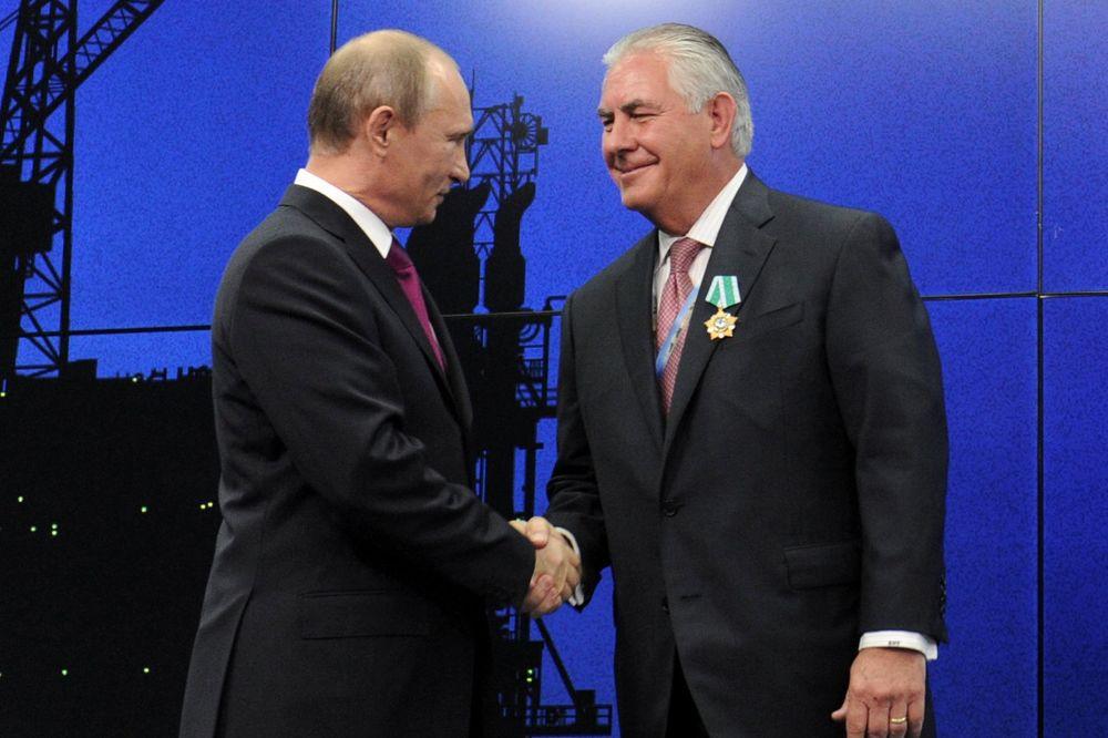 Vladimir Putin i Reks Tilerson, Foto Reuters