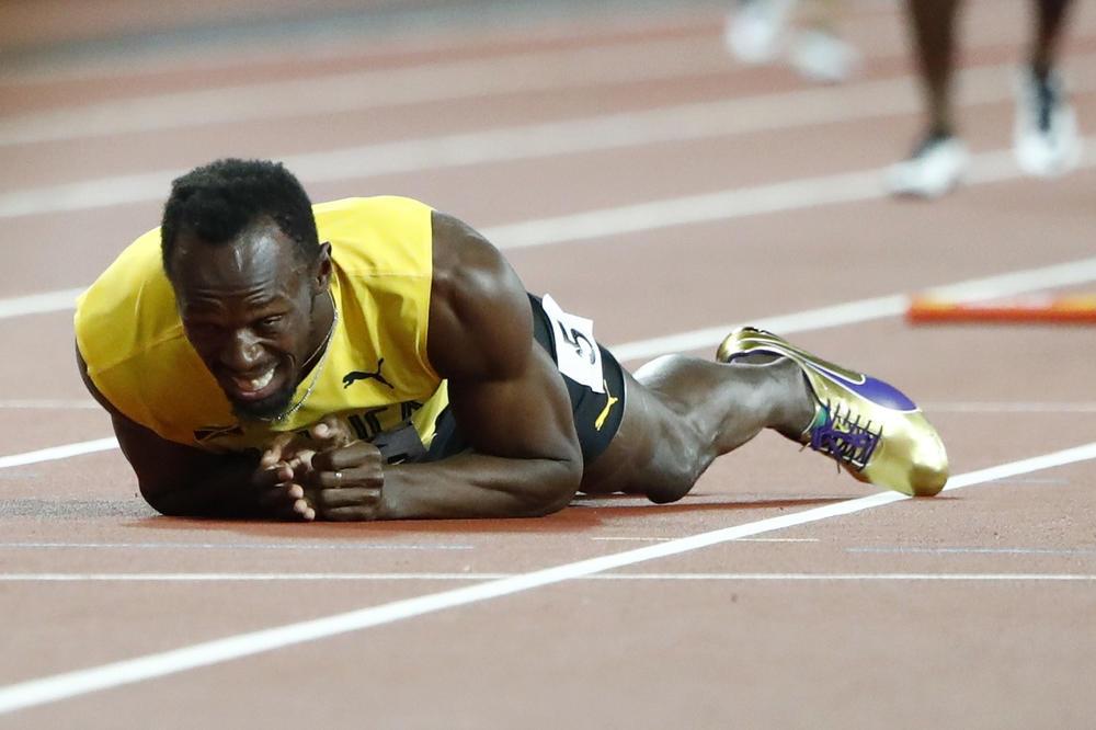 (VIDEO) TUŽAN KRAJ Svet u šoku ispratio Bolta u penziju: Najbolji sprinter svih vremena se povredio u poslednjoj trci karijere