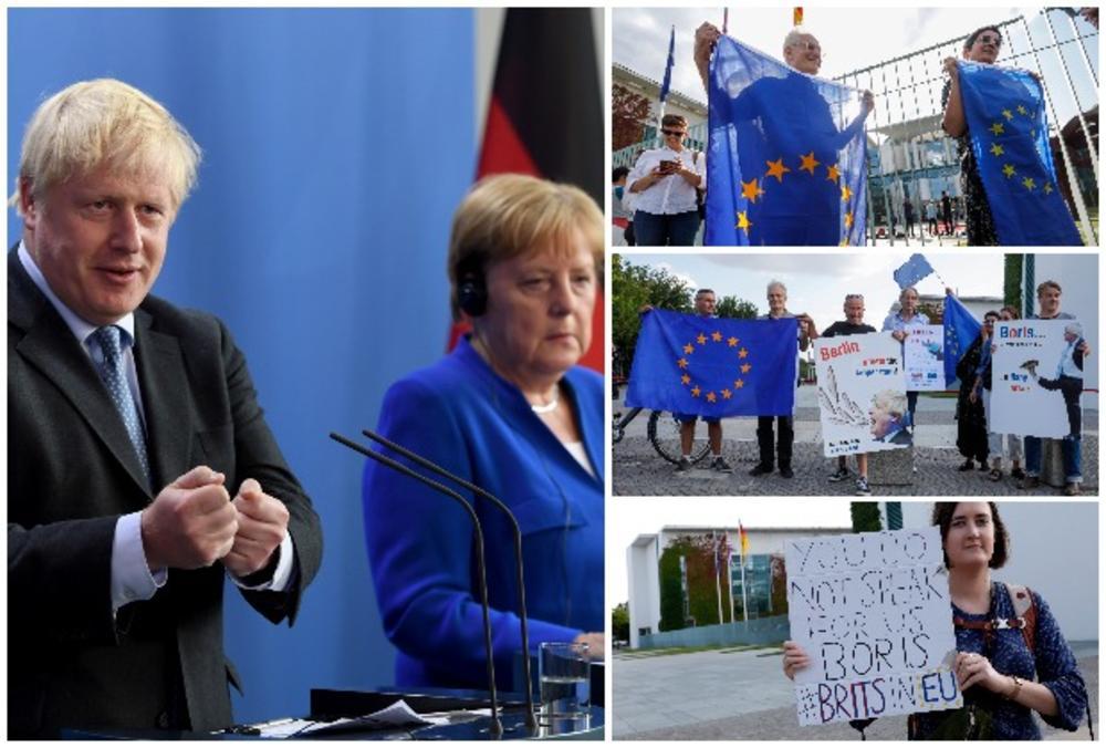 BORIS DŽONSON DOBIO OŠTRU PORUKU U BERLINU: Evo šta su demonstranti poručili britanskom premijeru pre sastanka sa Merkelovom (VIDEO, FOTO)